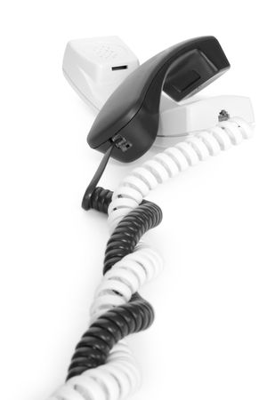 telecommunications concepts. two telephone handsets photo