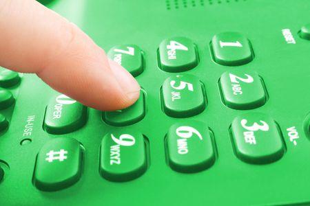 finger with green telephone keypad Stock Photo - 3904855