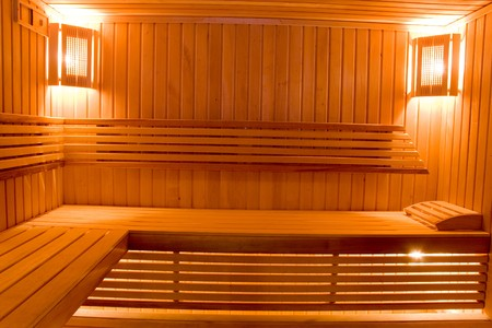 wooden sweating room with bench photo