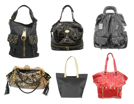 bagged: woman accessories. collection of handbags isolated on white Stock Photo