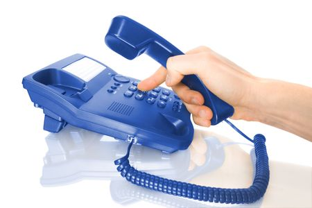 hand dialing on business blue telephone isolated on white photo