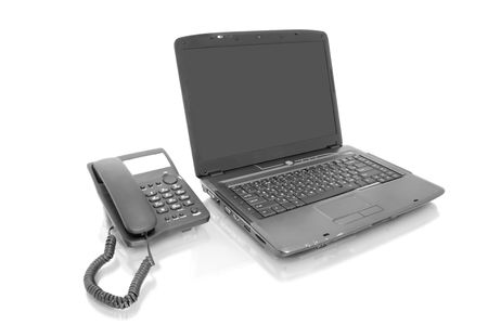 workplace. laptop with telephone isolated on white photo