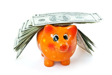 piggy bank with money isolated on white Stock Photo - 4796865