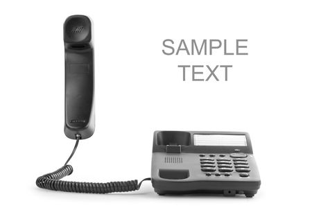 black office phone with the handset lifted upwards. with white place for text photo