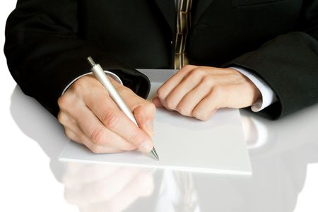 Businessman writes a pen on an empty paper Stock Photo - 5021755