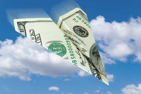 business concept. money plane over a sky background photo