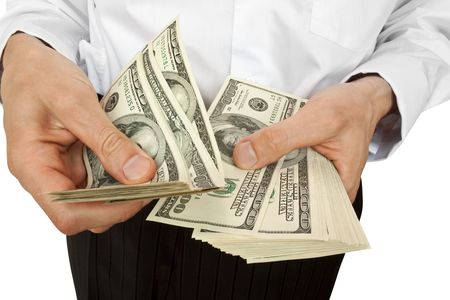 businessman counts money in hands. isolated on white Stock Photo - 5221070
