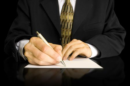 Businessman writes a pen on an empty paper Stock Photo - 5298530