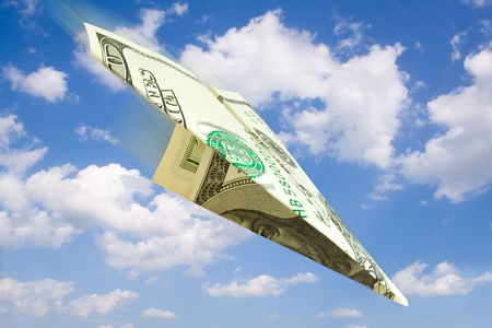 finance concept. money plane over sky with clouds photo