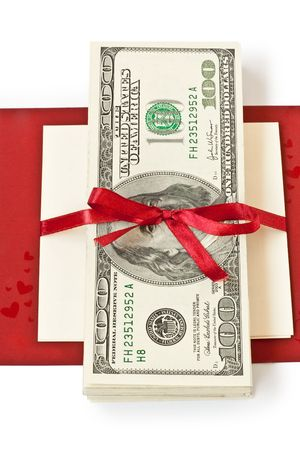 Roll of money with a red bow photo