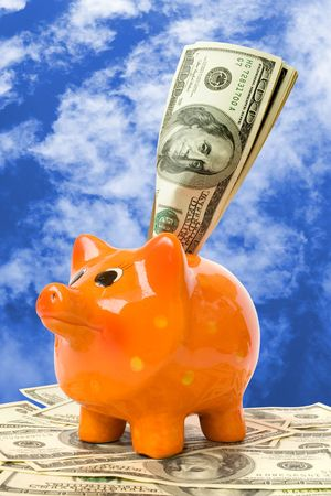 piggy bank with money over blue background Stock Photo - 5375109