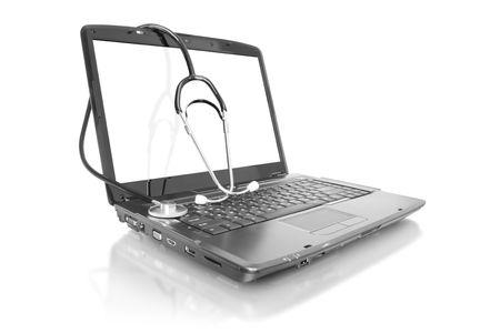 medicine technology. laptop with stethoscope isolated on white photo