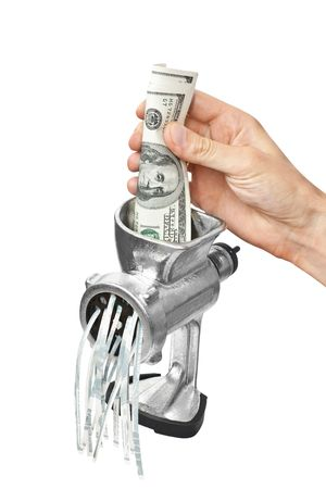 Money concept. Dollars are milled in a meat grinder isolated photo