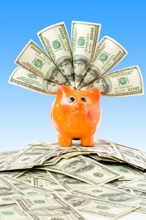 piggy bank with money over blue (finance concept) photo
