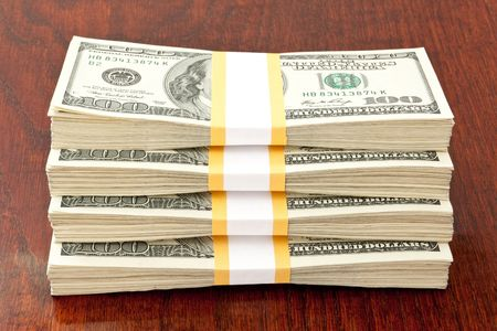 business concept. big stack of money over table photo