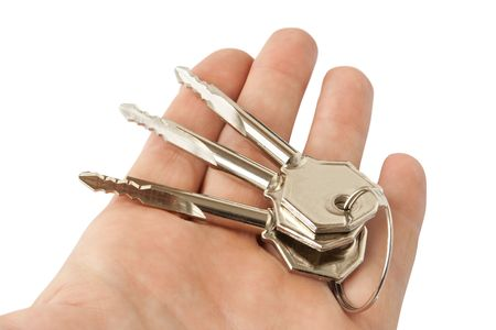 keys in the hand isolated on white photo