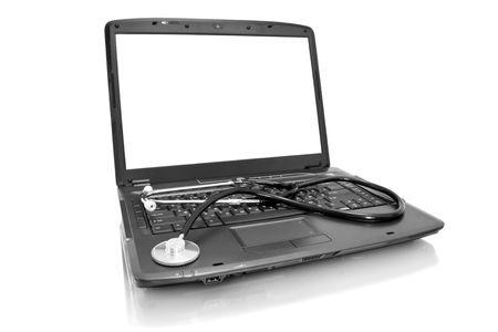 medicine technology;  laptop with stethoscope isolated on white photo