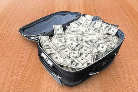 mucho dinero: conceptos de negocio. gran cantidad de dinero en una maleta Foto de archivo