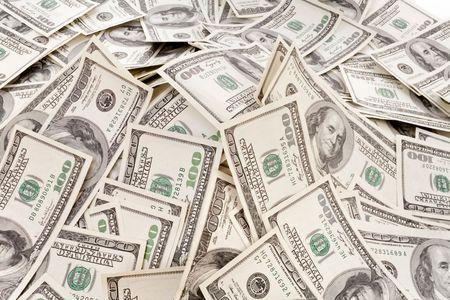 big pile of money. dollars over white background photo
