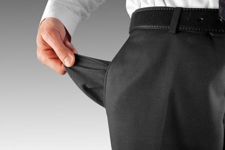 bankrupt business man showing empty pocket  hand