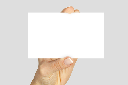 Womens fingers holding a blank business card isolated Stock Photo