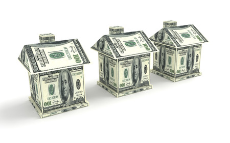 Three houses from the money isolated on white. Business concept