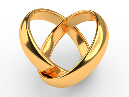 Heart with two connected gold wedding rings Standard-Bild