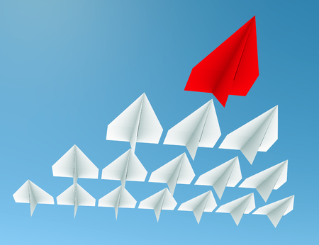 Leadership concept. One red leader plane leads other white planes forward Stock Photo