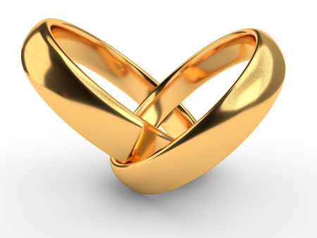 Heart with two connected gold wedding rings isolated on white Reklamní fotografie