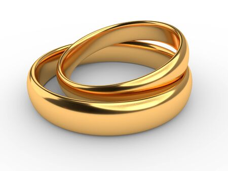 Two wedding gold rings lie on each other isolated on white 版權商用圖片