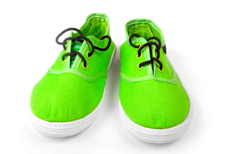 Footwear. Pair of green shoes isolated on white Reklamní fotografie
