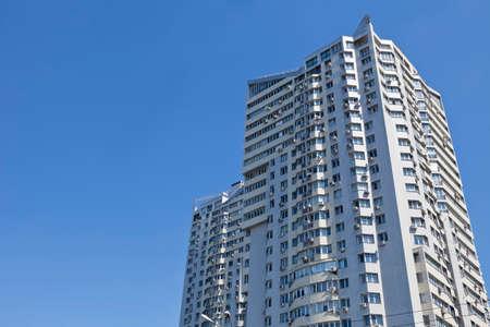 Real estate. Large multi-storey building on a blue sky Reklamní fotografie
