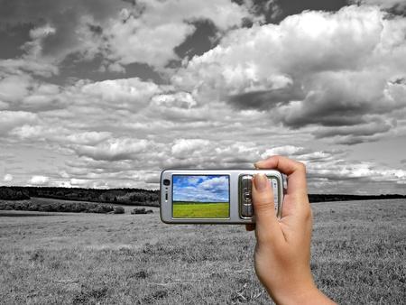 Black and white landscape coloured on smartphone dispay photo