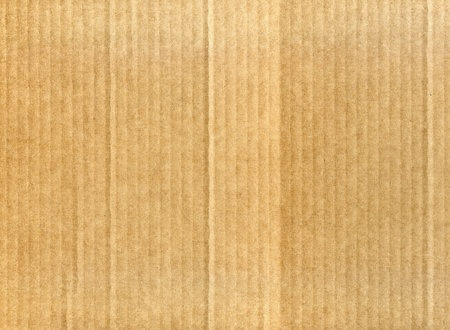 Textured corrugated cardboard with natural fiber parts photo