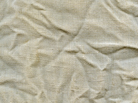Natural linen striped crumpled textured canvas background Stock Photo