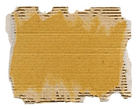 cardboard: Carton textur� avec les bords d�chir�s isol� sur blanc
