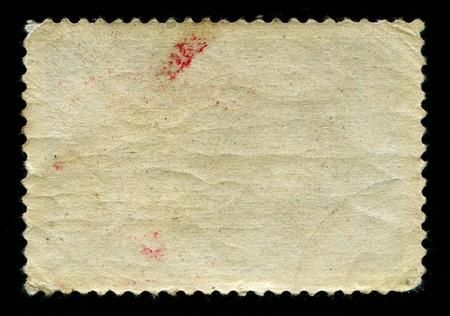 Back side of obsolete textured aged postage stamp