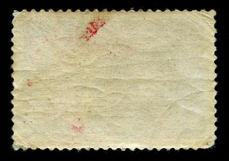 sello postal: El lado trasero de la obsoleta sello postal con textura de edad