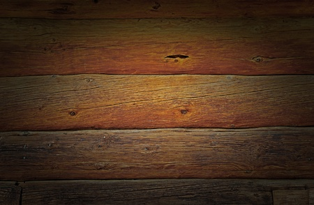 Weathered wooden logs wall of rural house grunge background photo