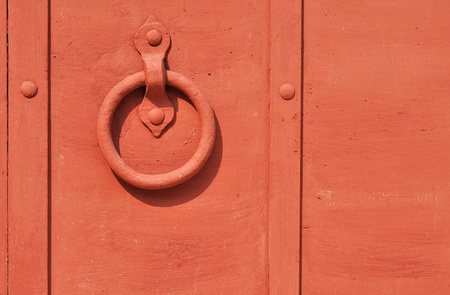 Red painted old iron door with circle doorhandle photo