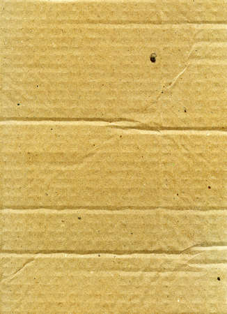 Textured recycled cardboard with natural fiber parts Stock Photo - 11697750