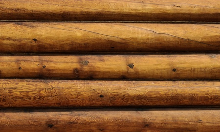 Weathered wooden logs wall of rural house background photo