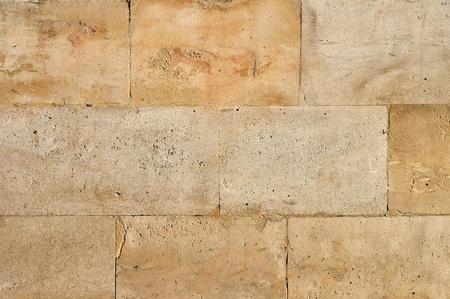 yellow stone: Antiguo muro de piedra erosionada azulejos fondo vintage