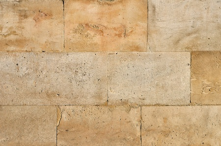 covering: Old weathered stone tiles wall vintage background