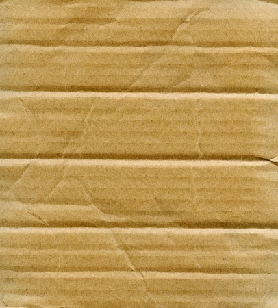 Textured recycled cardboard with natural fiber parts Stock Photo - 12589875