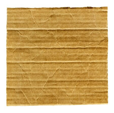 Textured ribbed recycled torn cardboard isolated on white photo
