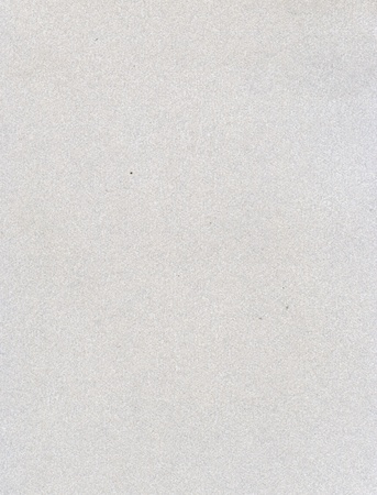 Textured grainy recycled paper with natural fiber parts