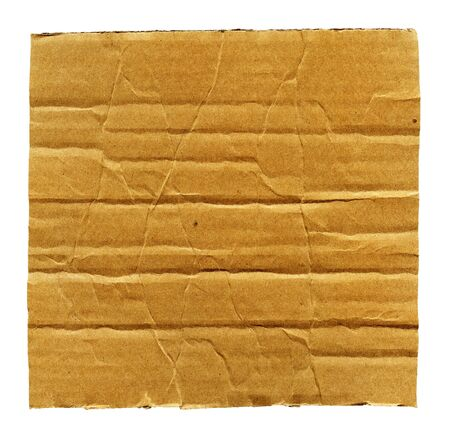Textured ribbed crumpled recycled cardboard isolated on white photo