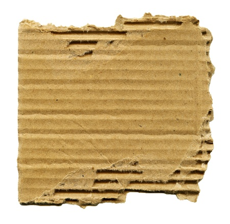 Textured cardboard with torn edges isolated on white photo