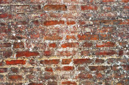 Old red bricks weathered damaged wall background Stock Photo - 13148772